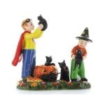 Kids in Costumes with Black Kittens from Santa Claus Christmas Store
